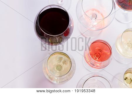 Set of glasses with red, white and rose wine, top view scene