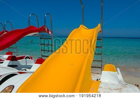 Pedal-boats With Water Slides On The Beach.