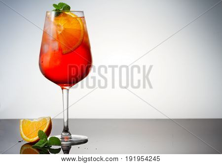 Glass of spritz coctail on table with copy space