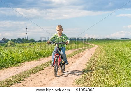 child boy ride bikes outdoors on a bicycle