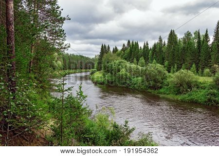Vyatka river flowing through the forest. Russia
