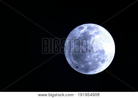 Full moon in dark background Image of a full moon against a black background