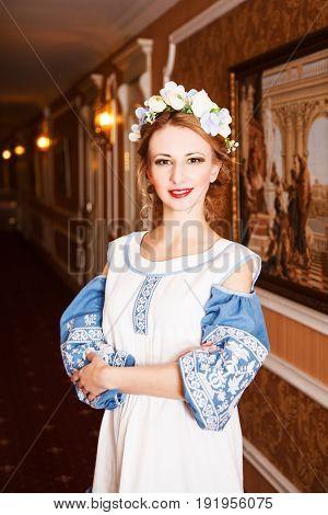 Portrait of attractive blonde woman in wreath