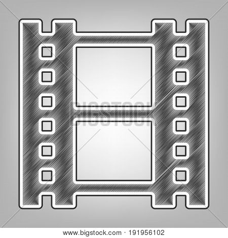 Reel of film sign. Vector. Pencil sketch imitation. Dark gray scribble icon with dark gray outer contour at gray background.