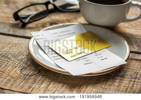 Coffee And Receipt Bill For Payment By Credit Card On Wooden Table Background