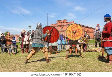 St. Petersburg Russia - 28 May, Fight with shields on swords,28 May, 2017. Knight tournament at the festival of ancient Vikings in St. Petersburg.