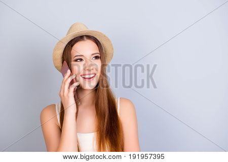 Roaming And Communication Concept. Young Cute Blond Tourist In A Hat Is Talking On Her Pda At The Va