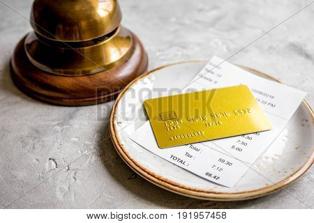 Paying Check For Lunch In Cafe With Credit Card On Stone Table Background