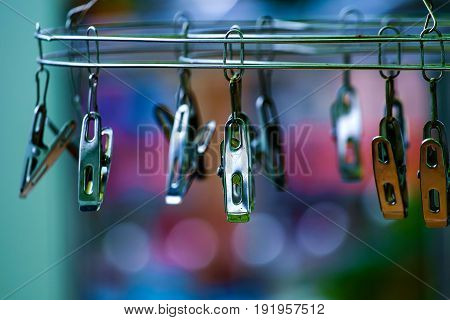 Stainless Clothes Peg Hanger on the blurred background
