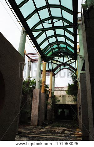 Tall ceilings of an abandoned mall, Saipan Tall pillars and glass ceilings of the abandoned La Fiesta Mall in San Roque, Saipan still stands after over a decade