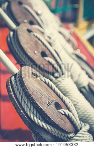 Ship pulley blocks and ropes closeup. Retro style, matte finish processing.