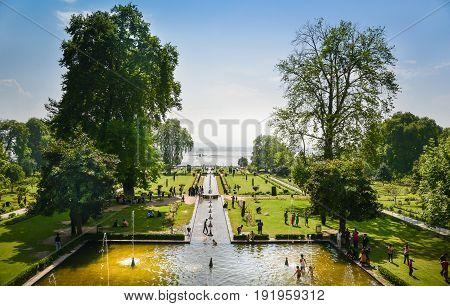 Nishat Bagh Garden, SRINAGAR,Kashmir and Jummu, INDIA-MAY 2017: Tourists enjoying spring in Nishat Bagh garden