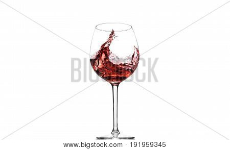A glass of wine in motion on the white background.