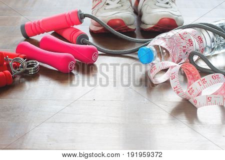 Sport equipments Fitness items and measuring-tape on wooden floor Healthy lifestyle