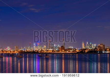 Melbourne Australia - December 27 2016: Melbourne city illuminated skyscrapers at night viewed from St. Kilda beach