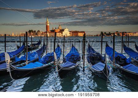 Gondolas seen againts the backdrop of the Church of San Giorgio Maggiore. Venice, Italy
