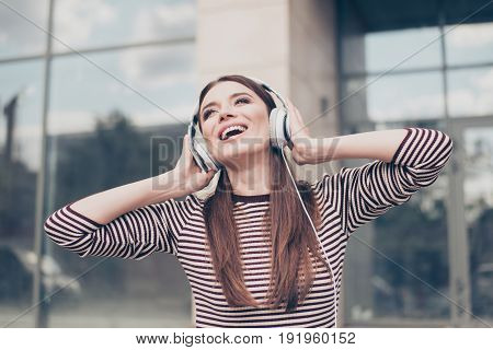 Amazed Dreamy Young Lady Is Listening To Her Favourite Song Outside, Walking On The Spring Street, W