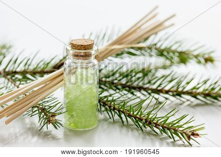 Spa With Organic Spruce Sea Salt In Glass Bottles On White Table Background