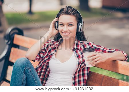 Nice Spring Weekend! Close Up Of A Dreamy Young Lady, Listening To Music Outside, Sitting On The Woo