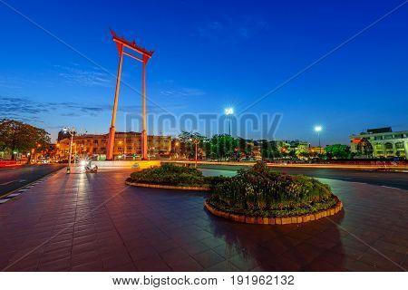 Moving blur light around the Giant swing landmark in the city / Sao Ching Cha