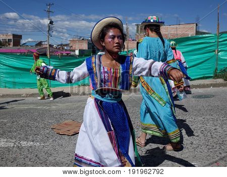 5TH JANUARY 2015 CHICHAGUÍ COLOMBIA - a girl in traditional indigenous dress dances at the Carnival de Blancos y Negros (Blacks and White Carnival) in Chichaguí near Pasto in Colombia