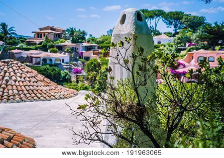 Cute mediterranean white houses with tile roofs of Porto Rafael, Palau, Sardinia, Italy.