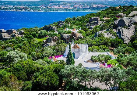 Beautiful costline with white houses and tile roofs of Porto Rafael, Palau, Sardinia, Italy.