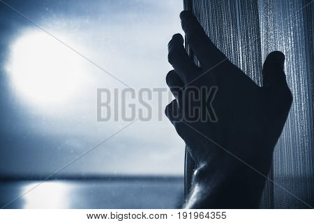 Male Hand Opens Tulle On A Window, Blue Toned