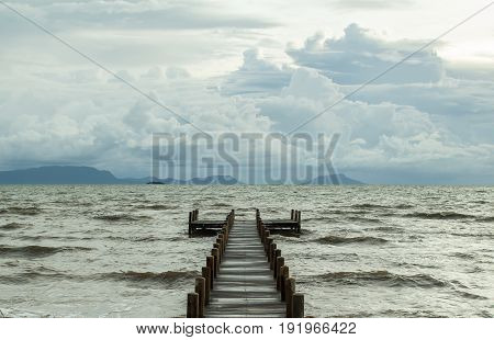 empty jetty and rough water during monsoon season