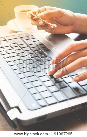 Woman hands using laptop and credit card Shopping online concept