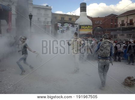 6TH JANUARY 2015 PASTO COLOMBIA - children throwing white powder at each other celebrating at the Carnival de Blancos y Negros (Blacks and White Carnival) in Pasto in Colombia