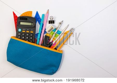 Student Pencil Bag Or Pencil Case With School Supplies For Student On White Background. Blue Pencil