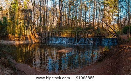 Panoramic view of the spillway waterfall and the tower in the Lullwater Park Atlanta USA