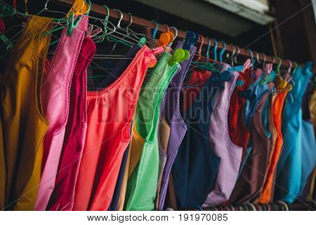 Decky garments in Thai market, souvenirs from Thailand, sweaters and garments.