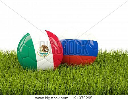 Two Footballs With Flags Of Mexico And Russia On Green Grass