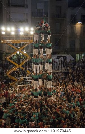 Reus, Spain - October 03, 2009: Castells Performance, a castell is a human tower built traditionally in festivals within Catalonia. and considered UNESCO Intangible Cultural Heritage of Humanity