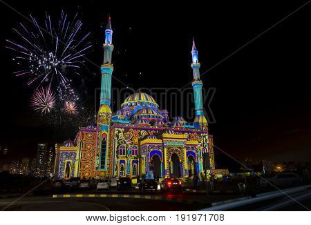 Beautiful fireworks in the sky behind mosque on the occasion of Eid.