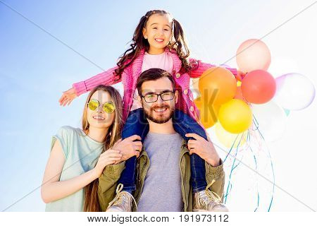 Cute couple spending time together with their daughter