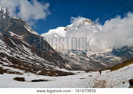 Backbackers in Himalayan mountains. Nepal, Annapurna region, Annapurna Base Camp track. Mountain Cloudy Landscape. Travel concept.