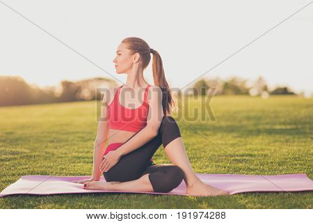 Healthy Morning. Cute Young Slim Trainer Is Stretching Her Fit Body. She Is Training Outdoors On A G