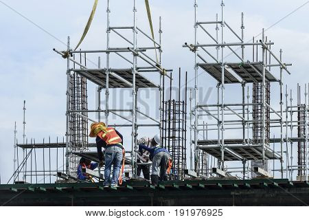 The worker at the construction site .Construction industry concept
