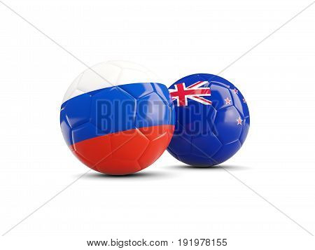 Two Footballs With Flags Of Russia And New Zealand Isolated On White