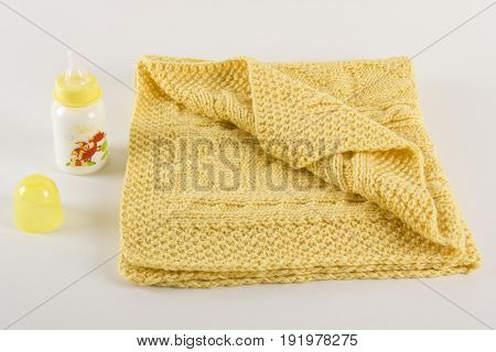 Children's knitted woolen blanket for the cold season