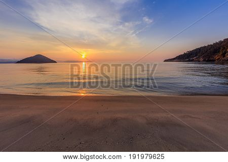 Paradise beach at sunrise. Thassos island Greece
