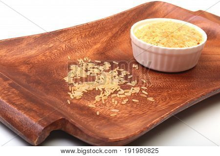Rice in a bowl on wooden background. ready for cooking