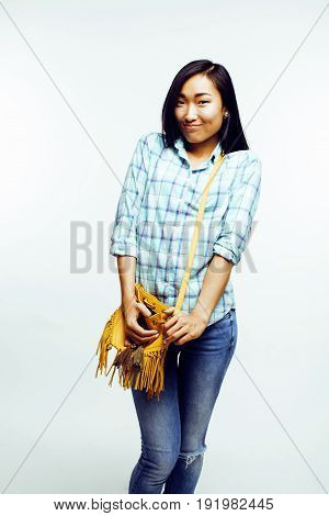 young pretty asian woman posing cheerful emotional isolated on white background, lifestyle people concept close up
