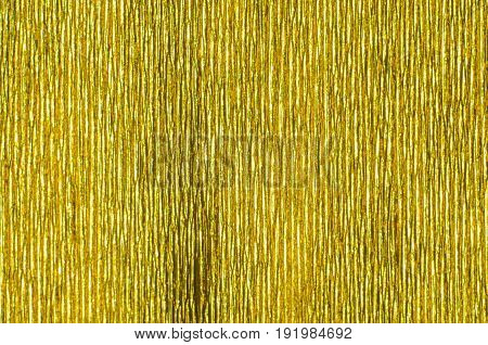 Gold Texture of Embossed Paper. Gold Paper Texture Background. Abstract background with deep grooves in the texture of corrugated paper. Pattern of vertical grooves