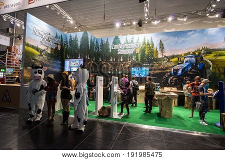 Cologne, Germany, August 13, 2014: Farming Simulator on gamescon. Gamescom is a trade fair for video games held annually at the Koelnmesse in Cologne.