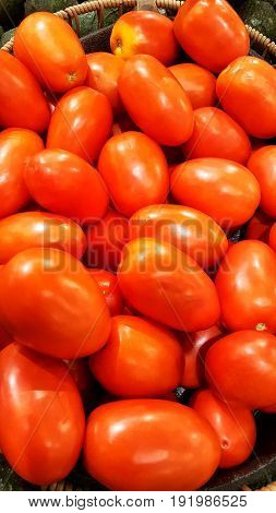 Basket of red and fresh Roma Tomatoes