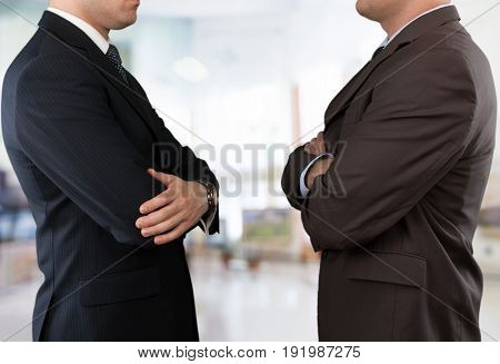Business men arms businessmen crossed suits crossed arms